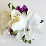 White and purple wrist corsage